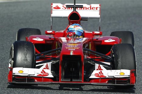 Ferrari's Formula One driver Fernando Alonso of Spain takes a curve during a training session at Circuit de Catalunya racetrack in Montmelo,