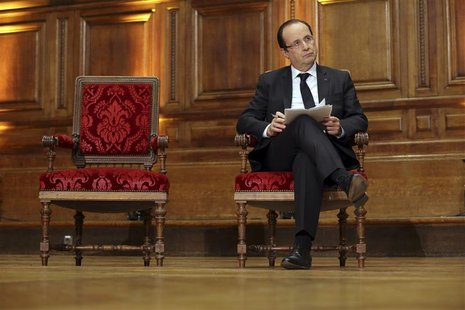 "French President Francois Hollande holds his notes as he attends a conference on ""Civil servants in Dictatorial Europe"" at the Sorbonne in P"