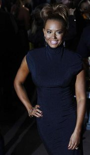 "Singer and former Spice Girl, Mel B, poses for photographers as she arrives for the European premiere of ""The Hunger Games"" at the O2 Arena"