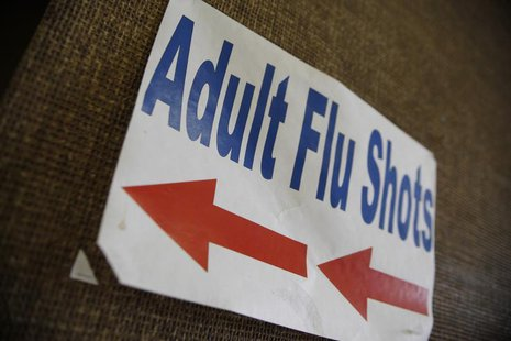 A sign advertising adult flu shots adorns the wall inside the Dallas County Department of Health and Human Services building in Dallas, Texa