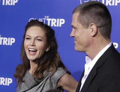 "Actor Josh Brolin and wife actress Diane Lane pose as they arrive for the premiere of the new film ""The Guilt Trip"" starring Barbra Streisan"
