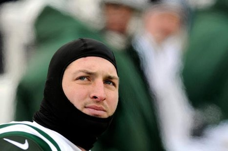 New York Jets quarterback Tim Tebow is on the bench against the Buffalo Bills in the third quarter of their NFL football game in Orchard Par
