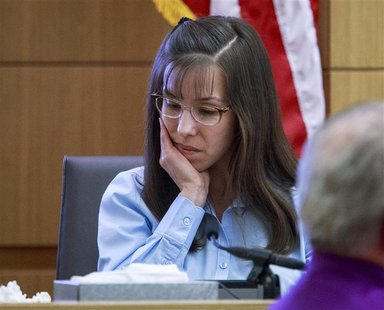 Defendant Jodi Arias tries to maintain composure as she testifies during her murder trial in Phoenix, Arizona February 20, 2013 for the June