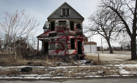 A vacant and blighted home, covered with red spray paint, sits alone in an east side neighborhood once full of homes in Detroit, Michigan Ja