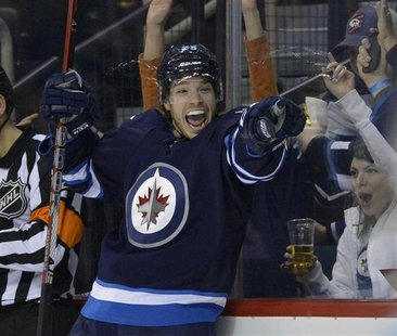 Winnipeg Jets' Zach Redmond celebrates his goal against the Toronto Maple Leafs during the second period of their NHL hockey game in Winnipe