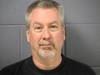 Former police sergeant Drew Peterson is pictured in this booking photo, released by the Will County Sheriff's Office on May 8, 2009. REUTERS