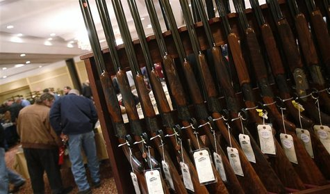 A row of shotguns are seen during the East Coast Fine Arms Show in Stamford, Connecticut, in this January 5, 2013 file photo. REUTERS/Carlo