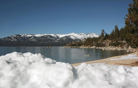 Snow is piled on a Lake Tahoe beach in Sand Harbor, Nevada February 3, 2012. REUTERS/Robert Galbraith