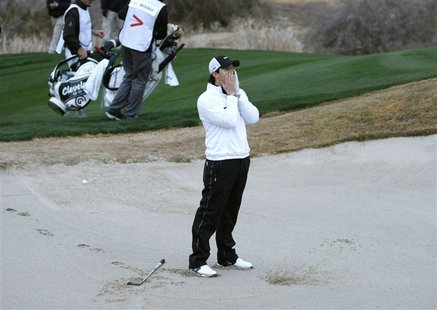 Northern Ireland's Rory McIlroy reacts after hitting out of the sand on the 18th in loss to Shane Lowry of Ireland during the weather delaye