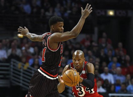 Miami Heat's Ray Allen (R) steals a pass intended for Chicago Bulls' Jimmy Butler during the first half of their NBA basketball game in Chic