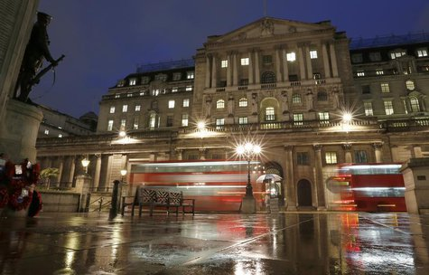 Busses pass the Bank of England in the city of London November 26, 2012. REUTERS/Olivia Harris