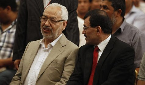 Ennahda movement leader Rachid Ghannouchi (L) speaks with Tunisian Interior Minister Ali Larayedh during the 2nd national congress of the Co