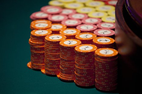 Casino chips are seen on a gaming table inside a casino on the opening day of Sheraton Macao hotel at Sands Cotai Central in Macau September