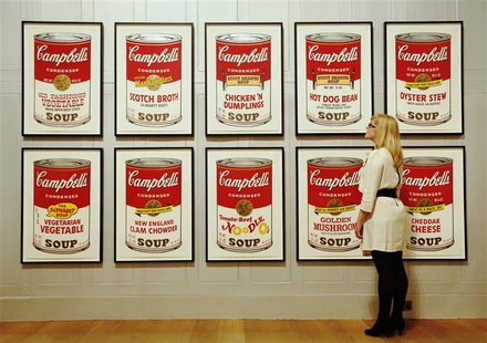 "Gallery employee Maddy Adeane poses with Andy Warhol's ""Campbell's Soup II"" (1969) at the Dulwich Picture Gallery in London June 19, 2012. R"
