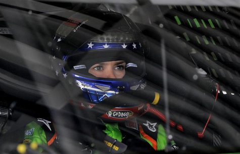 Danica Patrick adjusts her gear before leaving her garage in her number 10 Chevrolet during NASCAR Sprint Cup Series practice at the Daytona