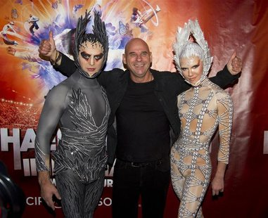 Guy Laliberte, CEO of Cirque du Soleil poses with performers as he attends the premiere of Michael Jackson THE IMMORTAL World Tour show by C