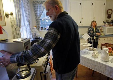 Ada May Roberts (R) and her husband Donald prepare breakfast for the guests at their Amelia Payson House Bed and Breakfast in Salem, Massach