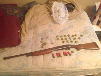 Drugs and firearms were found at the residence.