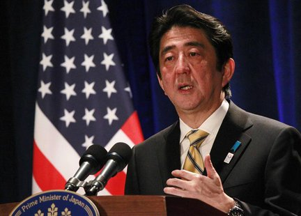 Japan's Prime Minister Shinzo Abe participates in a media conference at a Washington hotel, February 22, 2013. REUTERS/Jason Reed (UNITED ST