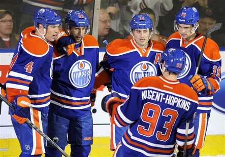 Edmonton Oilers' (L-R) Taylor Hall, Sam Gagner, Jordan Eberle, Ryan Nugent-Hopkins and Justin Schultz celebrate a goal against the Los Angel