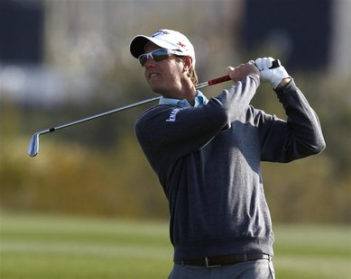 Nicolas Colsaerts of Belgium watches his second shot on the first hole during the second round of the WGC-Accenture Match Play Championship