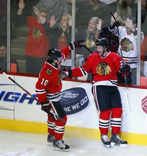 REFILE - ADDING NAME OF OPPONENT TEAM Chicago Blackhawks left wing Brandon Saad (R) celebrates his game winning goal with teammate Patrick S