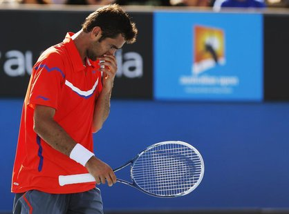 Marin Cilic of Croatia reacts during his men's singles match against Andreas Seppi of Italy at the Australian Open tennis tournament in Melb