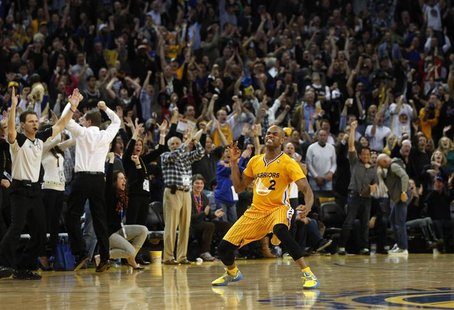 Golden State Warriors Jarrett Jack celebrates after making a three-point basket against the San Antonio Spurs late in regulation play during