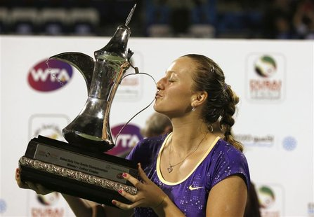 Petra Kvitova of the Czech Republic kisses the winner's trophy after her women's singles final match against Sara Errani of Italy during the
