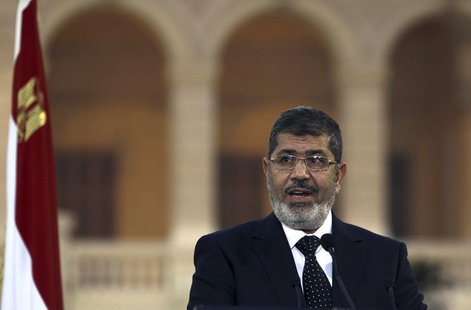 Egyptian President Mohamed Mursi speaks during a news conference with Turkish President Abdullah Gul (not pictured) after their meeting at P