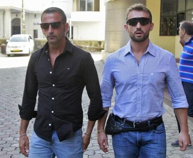Italian sailors Salvatore Girone (R) and Massimiliano Latorre leave the police commissioner office in the southern Indian city of Kochi Janu