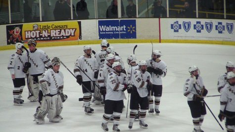 The Broncos celebrate after their 4-3 shootout victory over the Fighting Irish