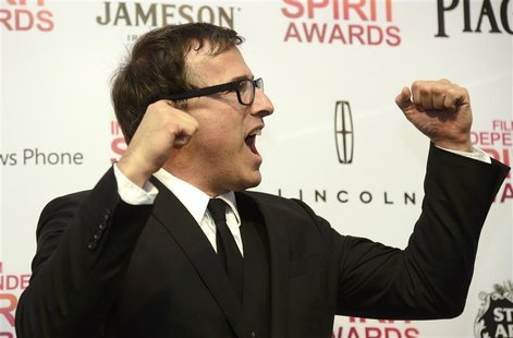 "Director David O. Russell celebrates in the photo room after his film ""Silver Linings Playbook"" won four awards at the 2013 Film Independent"