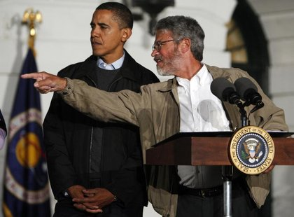 President Barack Obama (L) gets direction from White House science adviser John Holdren during an event to look at the stars with local midd