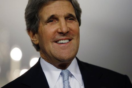 Secretary of State John Kerry smiles following his meeting with Canada's Foreign Minister John Baird (not pictured) at the State Department