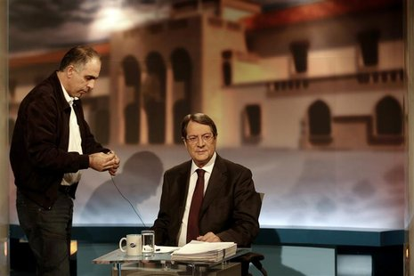 Cyprus presidential candidate Nicos Anastasiades of the right wing Democratic Rally party (R) waits for a televised debate to start in Nicos