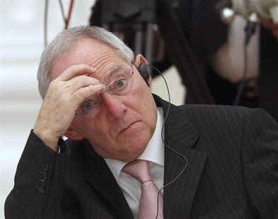 German Finance Minister Wolfgang Schaeuble reacts during a meeting of G20 representatives with Russian President Vladimir Putin in the Kreml