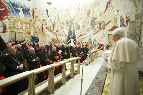 Pope Benedict XVI (R) speaks to Cardinals during the closing day of the Spiritual Exercises at the Vatican February 23, 2013. REUTERS/Osserv