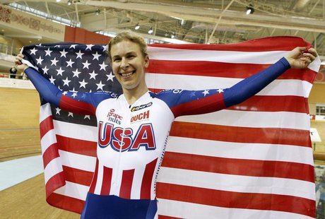 USA's Sarah Hammer reacts as she wins the gold medal during women's omnium time trial final at the 2013 UCI Track Cycling World Championship