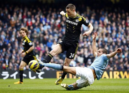 Manchester City's Jack Rodwell (R) challenges Chelsea's Gary Cahill during their English Premier League soccer match at The Etihad Stadium i