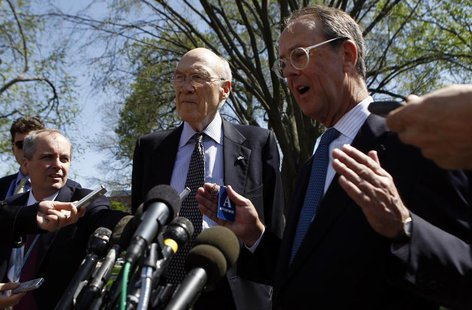 Fiscal Commission co-chairs Alan Simpson (C) and Erskine Bowles (R) speak to reporters after their meeting with U.S. President Barack Obama