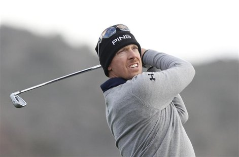 Hunter Mahan of the U.S. watches his tee shot on the third hole during the semifinal round of the WGC-Accenture Match Play Championship golf