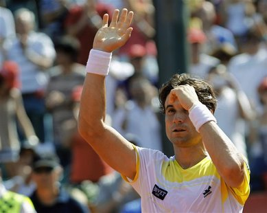 Spain's David Ferrer waves to spectators after defeating Switzerland's Stanislas Wawrinka in the Buenos Aires Open men's single tennis match