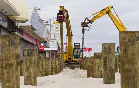 A construction crew puts pilings into the sand as the reconstruction of the boardwalk continues in Seaside Heights, New Jersey, February 22,