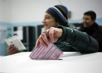 A woman casts her vote in a polling station in Rome February 24, 2013. REUTERS/Yara Nardi
