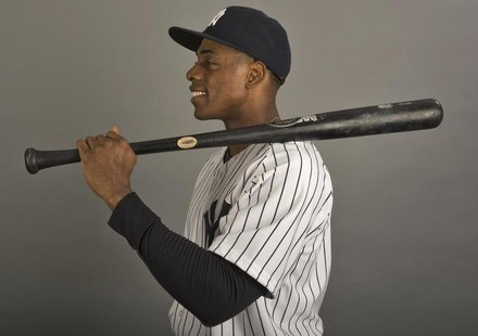 New York Yankees outfielder Curtis Granderson poses for a photograph during media photo day at the team's MLB spring training complex at Geo