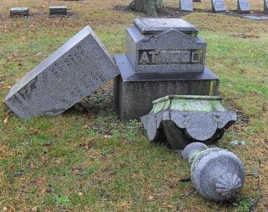 Just some of the damage to headstones at Riverside Cemetery. (photo courtesy Dowagiac Police)
