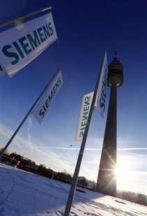 Flags of German engineering conglomerate Siemens AG flutter before the company's annual shareholder meeting in Munich January 23, 2013. REUT