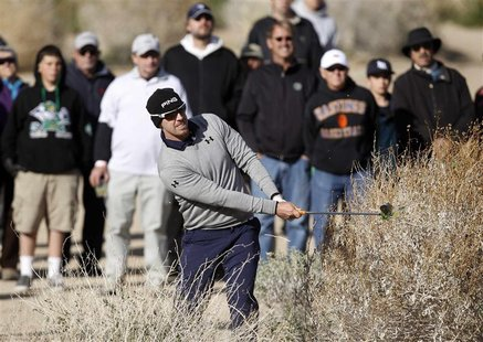 Hunter Mahan of the U.S. hits out of the bushes on the 17th hole during the championship match of the WGC-Accenture Match Play Championship