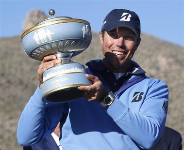 Matt Kuchar of the U.S. holds the trophy after beating Hunter Mahan 2&1 during the championship match of the WGC-Accenture Match Play Champi